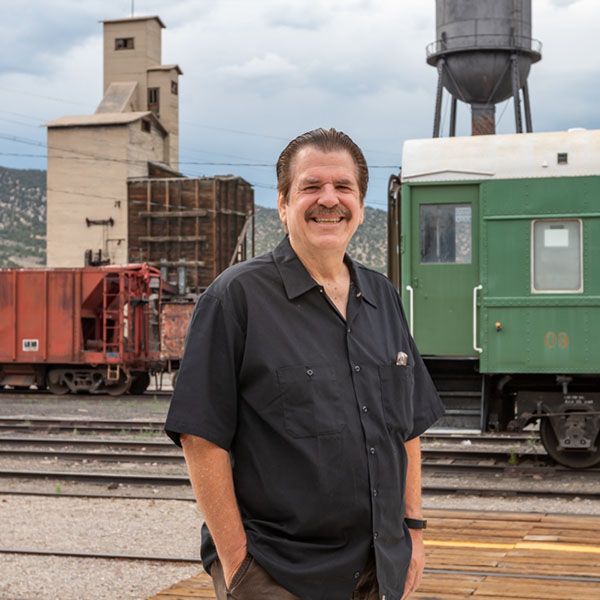 Man next to railroad track at The Northern Nevada Railway Museum