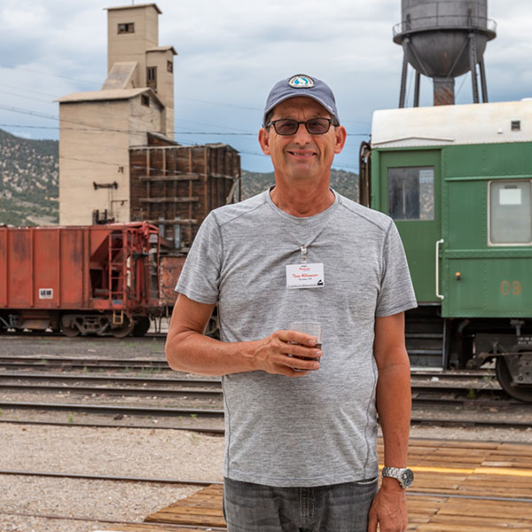 Tourist Man next to trains at The Northern Nevada Railway Museum